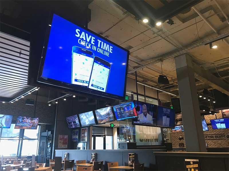 Buffalo Wild Wings, Supercuts, MLB and REACH Digital Signage