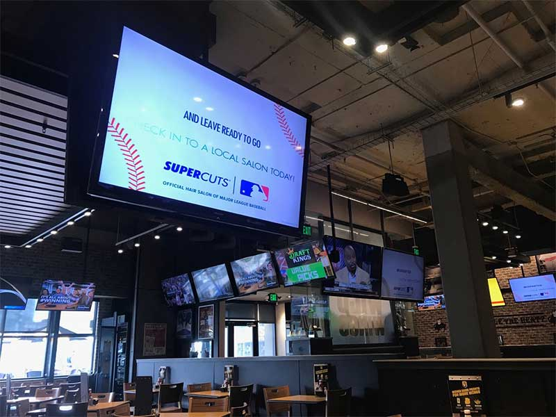 Buffalo Wild Wings, Supercuts and REACH have partnered together to create a digital signage experience